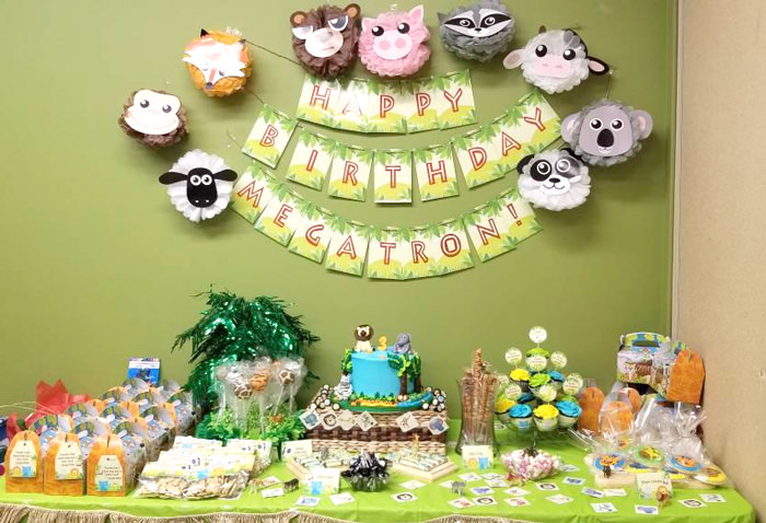 Jungle Party dessert table with banner on wall