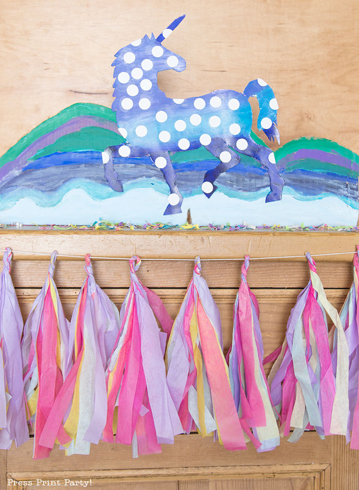 multicolored tassels on buffet with unicorn