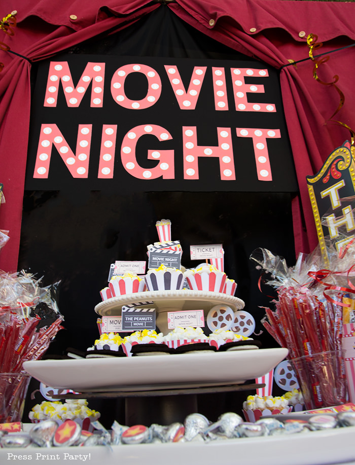 Movie night marquee. Backyard movie night dessert table.Backyard movie night party ideas - Movie night cupcakes with popcorn - Printables by Press Print Party!