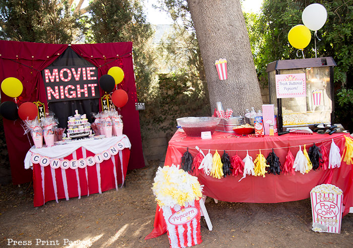 Backyard movie night party ideas - Movie night cupcakes with popcorn - Printables by Press Print Party!