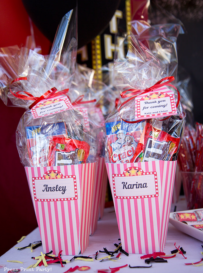 Movie night favors in popcorn boxes with tags. Printables by Press Print Party!