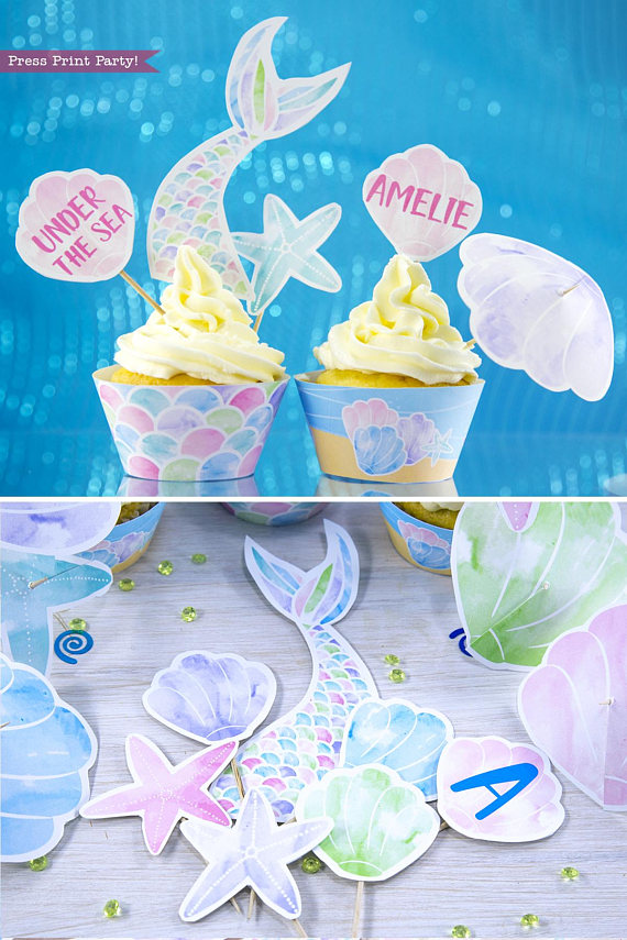 Mermaid cupcakes. Printable cupcake toppers and wrappers. 2 cupcakes with mermaid tail and shells topper. Printables by Press Print Party!