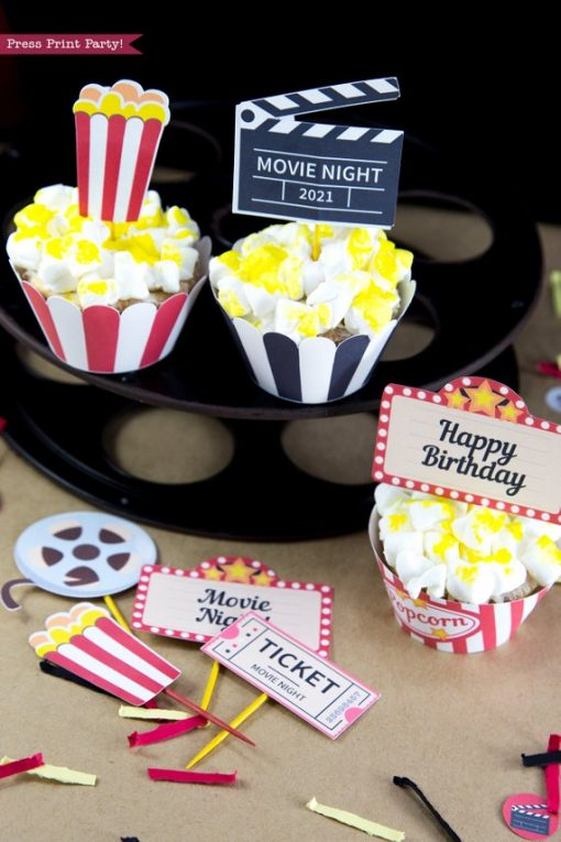 Movie night popcorn cupcakes on top of a movie reel. cupcake wrappers and toppers printables by Press Print Party!