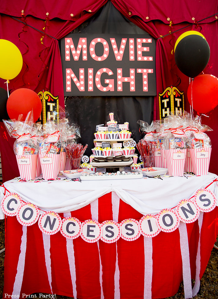 Backyard movie night dessert table with marquee.Backyard movie night party ideas - Movie night cupcakes with popcorn - Printables by Press Print Party!