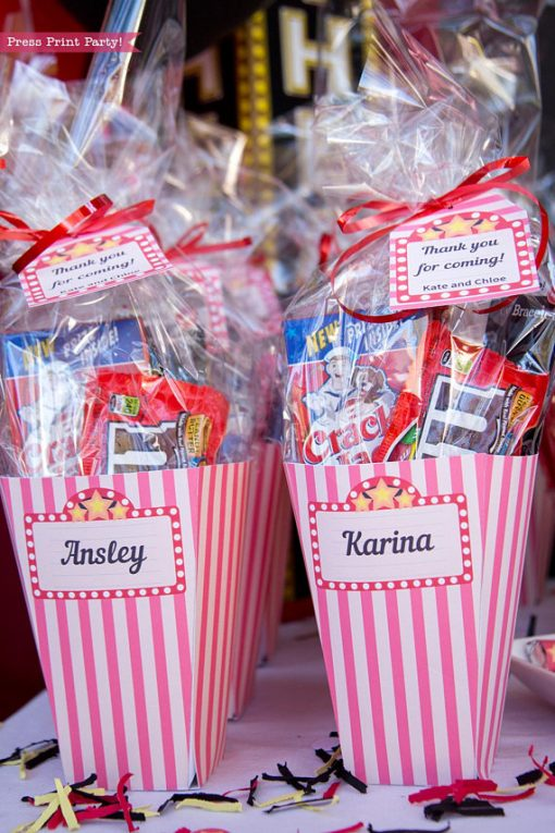Movie Night Popcorn boxes favor boxes filled with favors and a tag. Press Print Party!