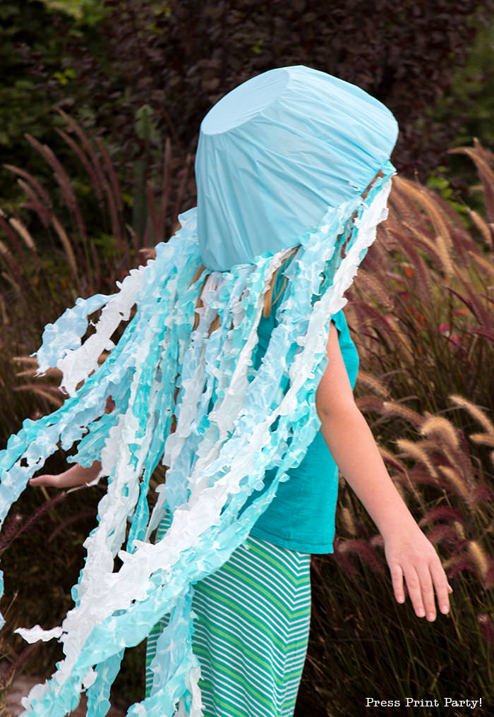 Girl with jellyfish costume for Halloween. Blue and white tentacles. light up jellyfish costume. led. under the sea costume. homemade. led costume. jelly fish costume. Press Print Party!