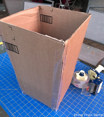 open box to make a popcorn box pinata- Press Print Party!