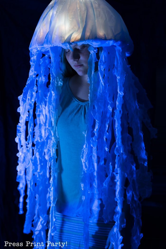 Girl with light up jellyfish costume at night. Press Print Party!