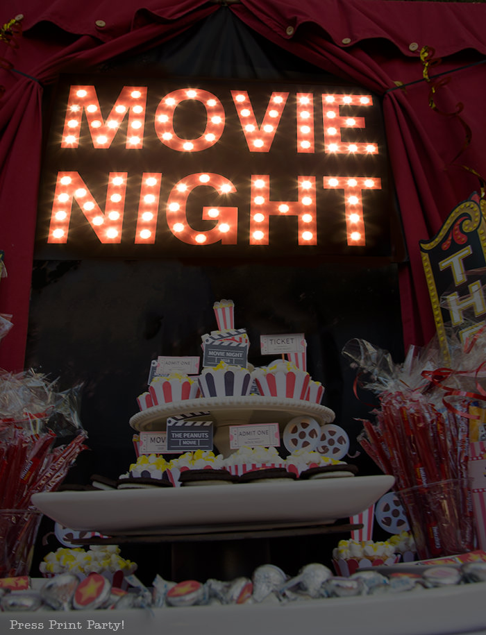 Movie Night lit up theater marquee lights with a tower of cupcakes - Press Print Party!