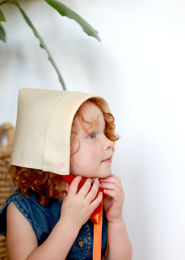 Girl with bonnet made out of felt
