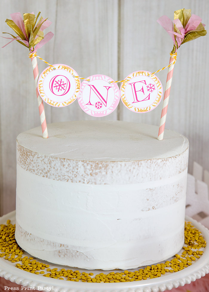 Winter onderland cake with toppers and gold sprinkles - Press Print Party!