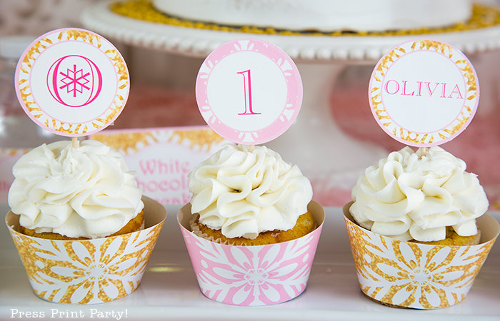winter onederland birthday party cupcakes with pink wrappers and gold wrappers and editable toppers. - Press Print Party!