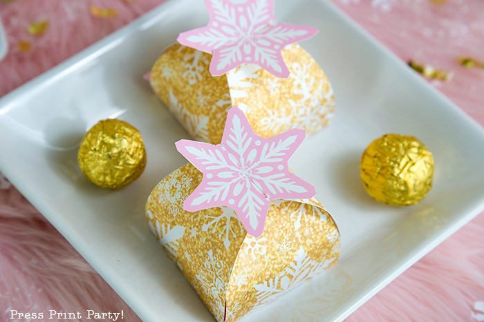 gold snowflake favor boxes with a pink interlocking snowflake on top. Press Print Party!