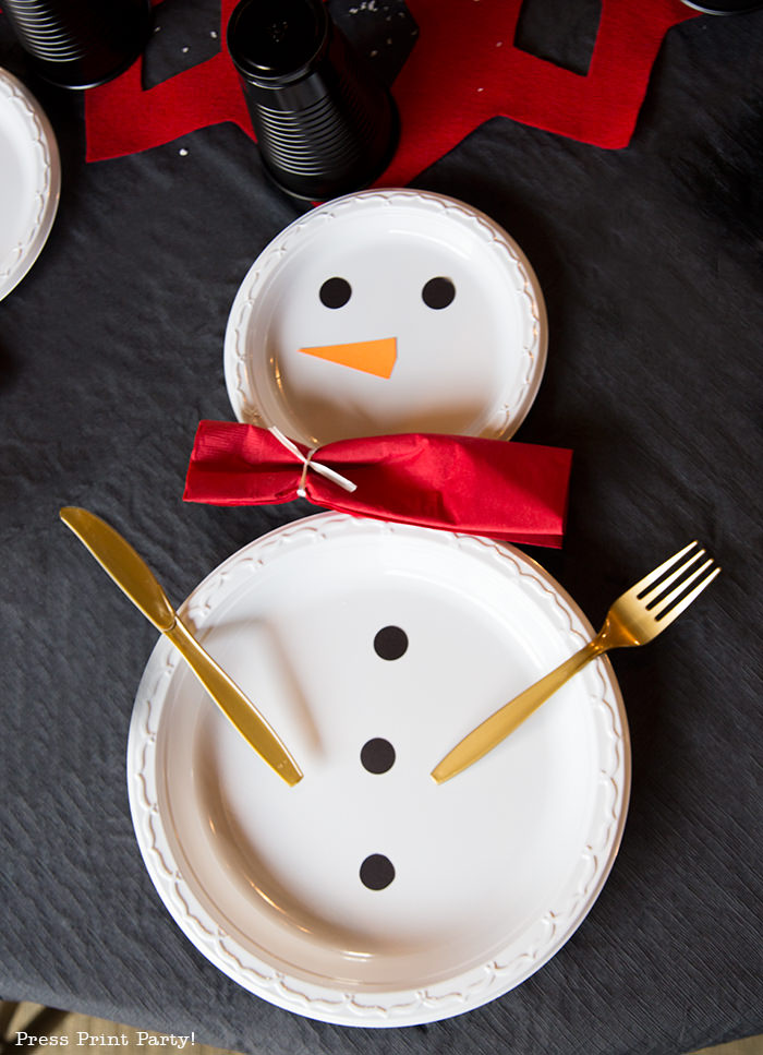 snowman made with white plates and a red napkin scarf - Press Print Party!