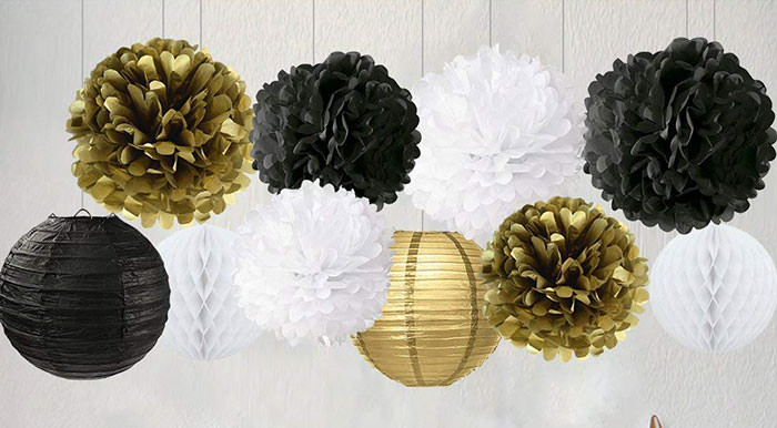white, gold, and black hanging decorations new years