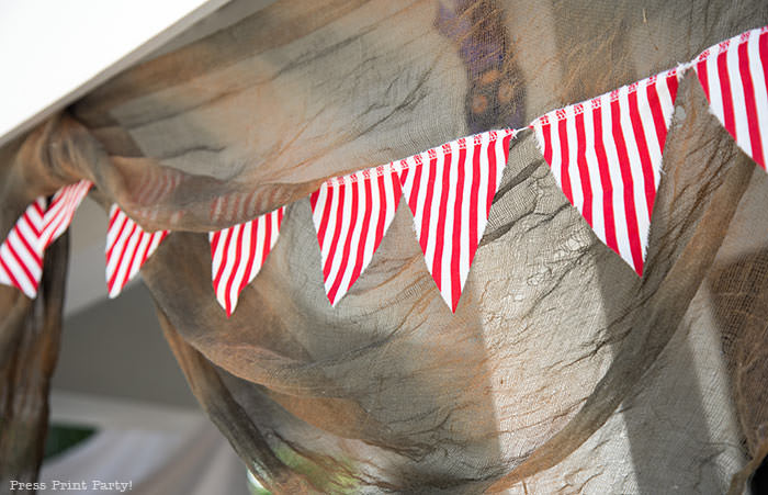close up of pirate banner with red and white striped fabric. Press Print Party!