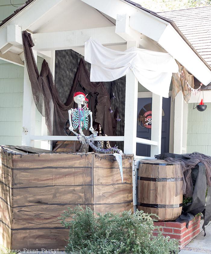 diy pirate ship- haunted pirate ship- Halloween porch decor ideas - Halloween Front porch ideas - Halloween porch decor - pirate decorations - Pirate skeleton - Mermaid skeleton - Press Print Party!