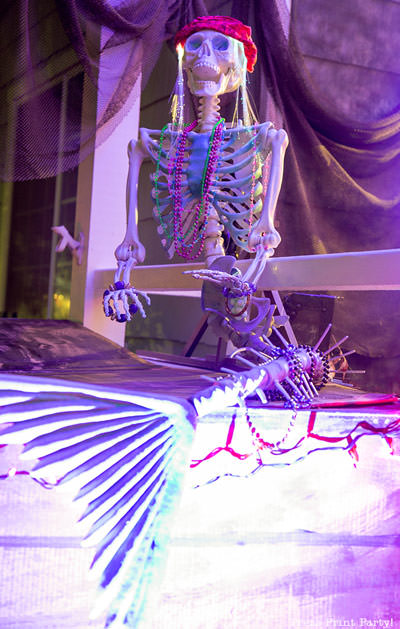 skeleton mermaid on DIY pirate ship made out of cardboard. halloween front porch decoration idea. night lighting LED purple light - Press Print Party!