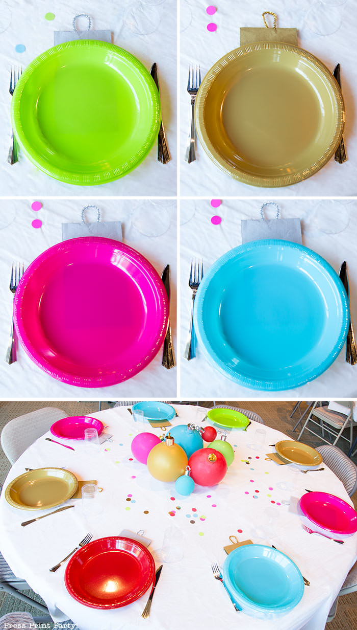over the top shot of a Christmas party table round. Christmas tablescape balloon centerpiece decoration with large ornament balloons and plates that look like ornaments. Very cheery and bright. Fun and creative for your Christmas party. Simple Christmas balloon decor ideas diy. Press Print Party!
