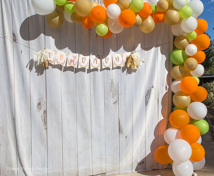 Oh baby banner woodland theme baby shower forest animals. with organic balloon garland in orange, gold, green, and white. White wood backdrop. Woodland Animals Baby Shower Theme with woodland creatures and forest animals party supplies. Woodland decoration girl baby shower ideas. Can be used for woodland birthday party. Rustic forest animals with flowers and antlers. Fox baby shower, Deer baby shower.