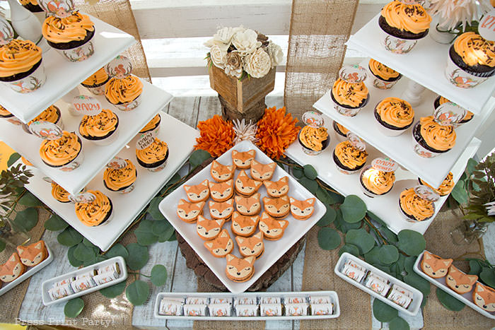 Woodland baby shower dessert table with cupcakes towers and fox macarons. Woodland animals Baby Shower Theme with woodland creatures and forest animals party supplies. Woodland decoration girl baby shower ideas. Can be used for woodland birthday party. Rustic forest animals with flowers and antlers. Fox baby shower, Deer baby shower.