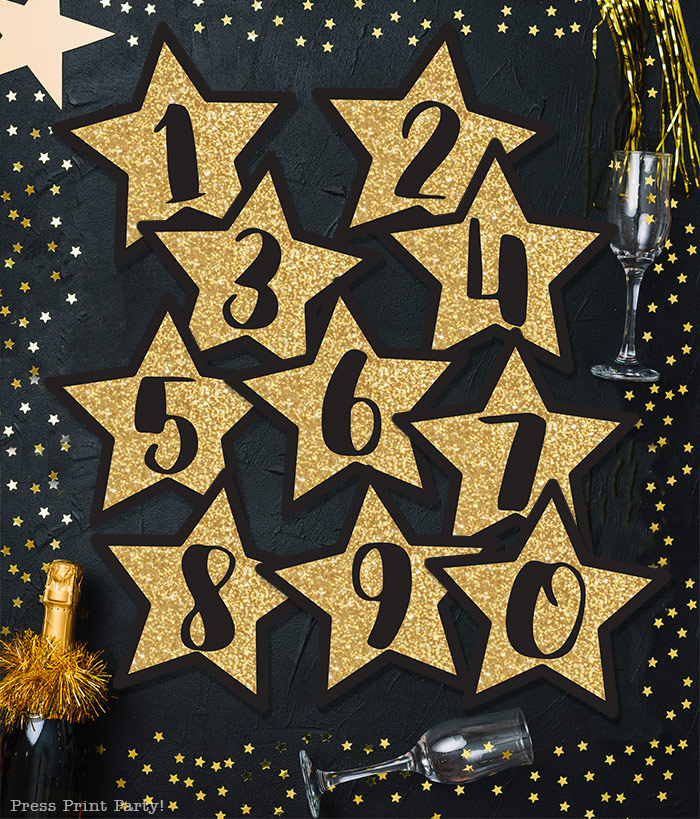 Free New year's printable banner. make for any year. For your new years eve party.all numbers included. large Gold star with black numbers. free printable by Press Print Party! Happy new year!