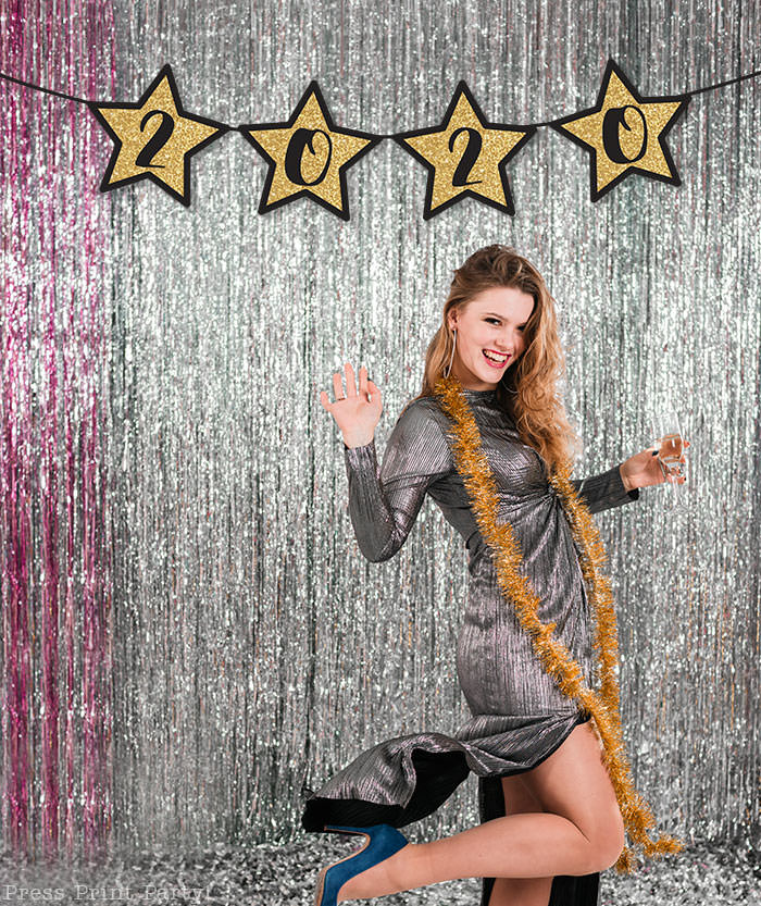 Free New year's printable banner. make for any year. For your new years eve party.all numbers included. large Gold star with black numbers. free printable by Press Print Party! Happy new year! 2020