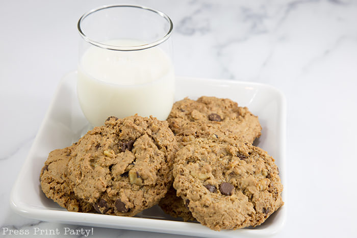best ranger cookies recipe. chocolate chips and rice krispies cookies on plate with milk