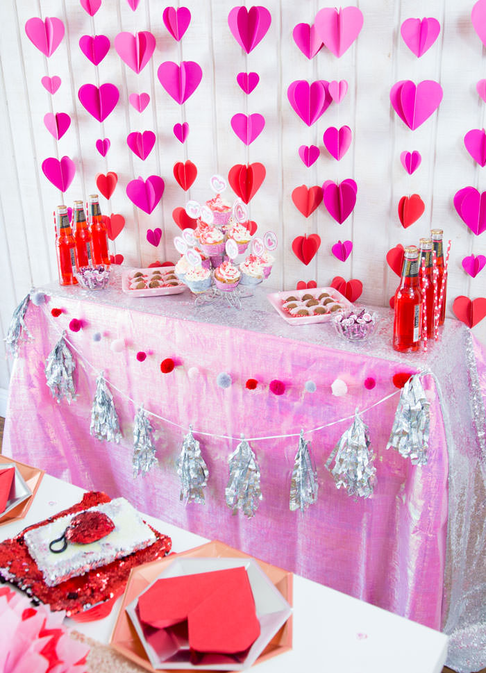 Galentines day party ideas decorations DIY, activities, favors. Happy Galentine's Day- Dessert table with Heart garland, tissue paper flowers, heart napkin, flip sequins hearts and bag, cupcakes, chocolate truffles - - Press Print Party!