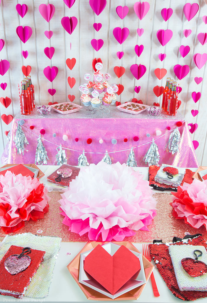 Galentines day party ideas decorations DIY, activities, favors. Happy Galentine's Day- Dessert table with Heart garland, tissue paper flowers, heart napkin, flip sequins hearts and bag, cupcakes, chocolate truffles - Press Print Party!