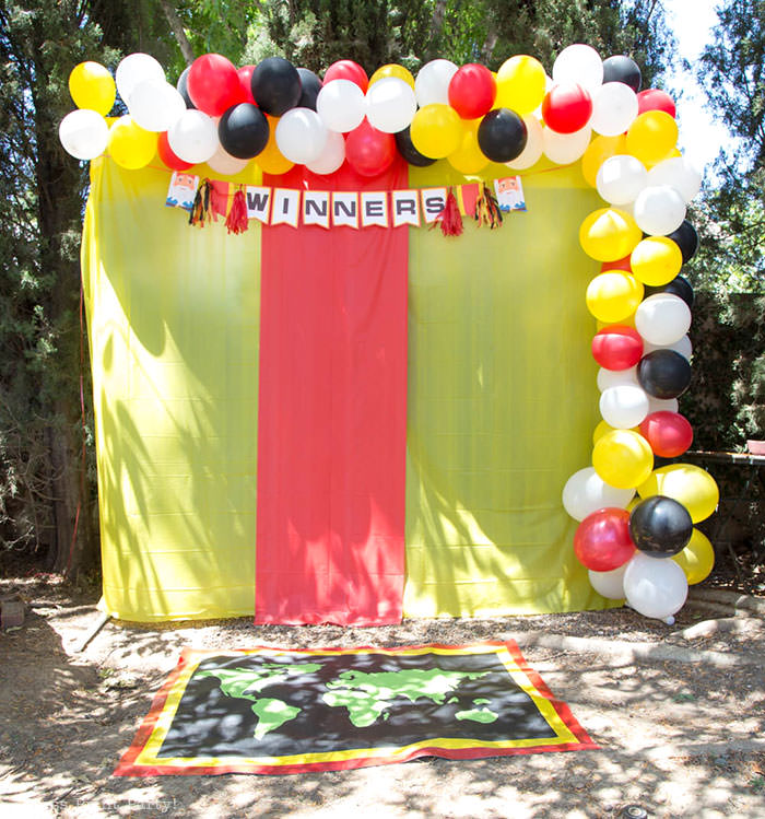 Backdrop with balloons and winner pit stop mat The amazing race party ideas - Press Print Party!