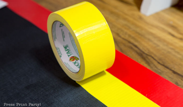 Red and yellow duct tape to use on the edges of the homemade amazing race pit stop mat.