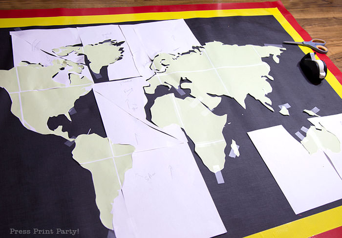 Homemade amazing race pit stop mat with map printout before painting.
