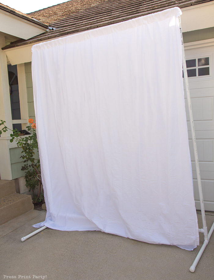 PVC Backdrop frame DIY on ground assembled with curtain- Press Print Party!