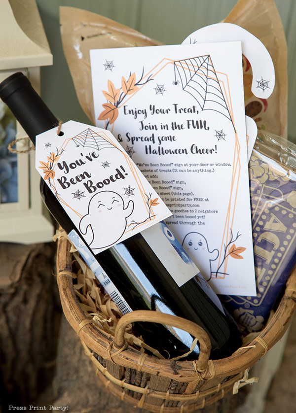 FREE printable You've been booed sign with basket with wine and popcorn. by Press Print Party!