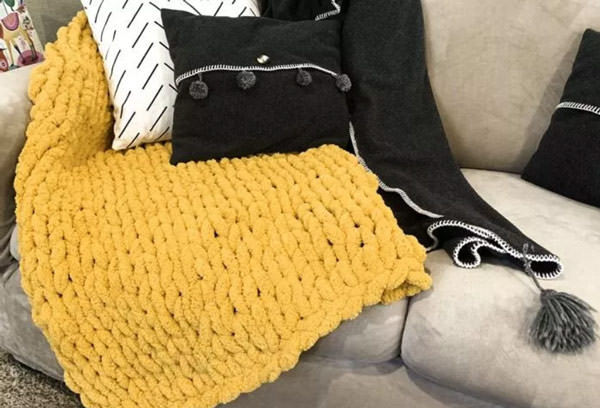 Chunky hand knitted blanket in yellowe to make for gift for mom