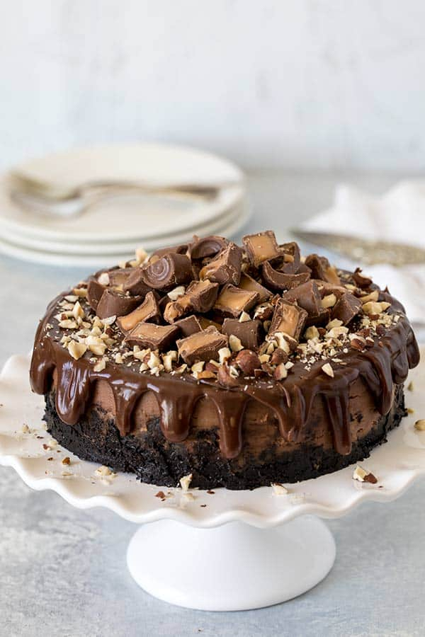 A Rich Creamy Decadent Nutella Cheesecake Topped With Chocolate Ganache Rolo Cans