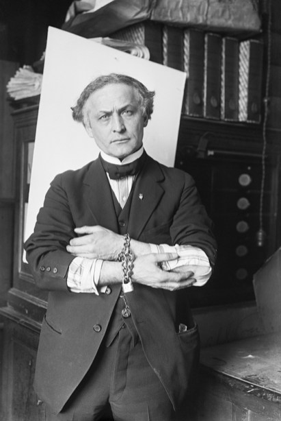 Houdini Showing How To Escape Handcuffs
