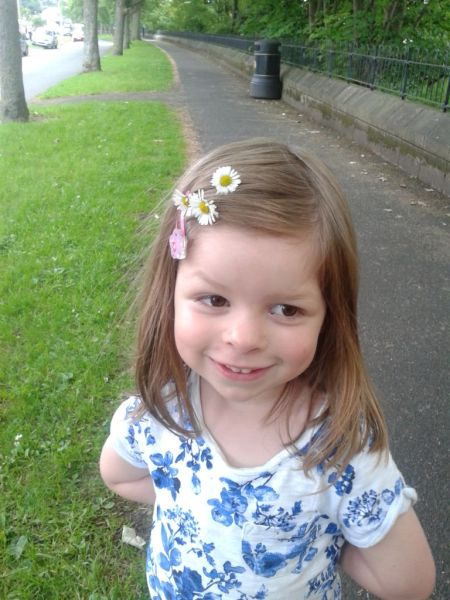 Daisies, detail, daisies in hair, four year old girl, outdoors, pretty