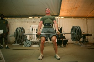 Lance Cpl. Christopher J. Talbot, a scout with Charlie Company, 2nd Light Armored Reconnaissance Battalion, Regimental Combat Team 5, dead-lifts 475 pounds during a daily work out at Camp Korean Village, Iraq, May 6. The native of Torrington, Conn., began working out at age 10 when his mom decided to attend aerobics classes at the local YMCA. While his mother was engaged in her workouts, he took the opportunity to achieve what would become his life long goal: becoming a professional body builder.