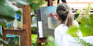 Women painting in garden