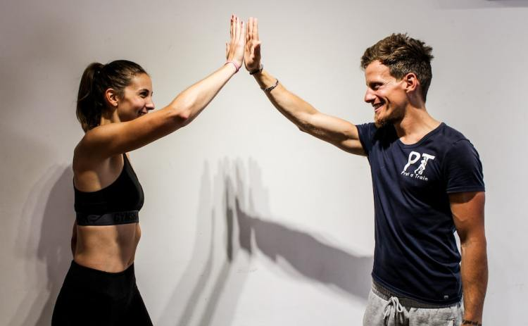 Personal trainers in Singapore with client happy