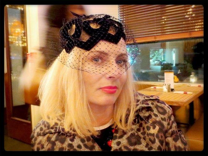 Veiled 1950s vintage hat on blonde woman