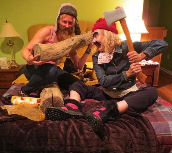 girls with axes in bed dressed as lumberjacks wearing beards