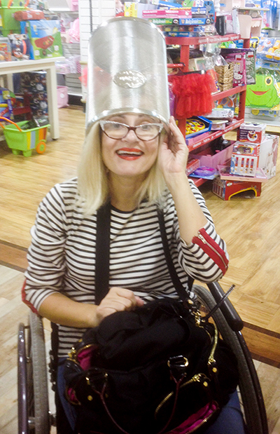 Wheelchair disabled blogger with trash bin on her head