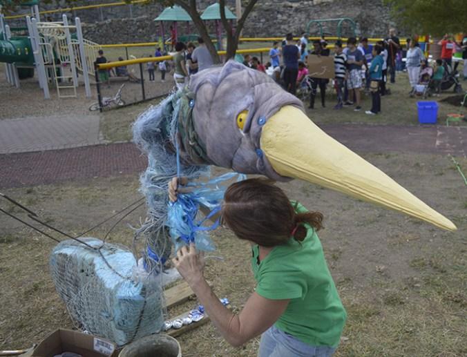 Joan Harmon and her bird sculpture
