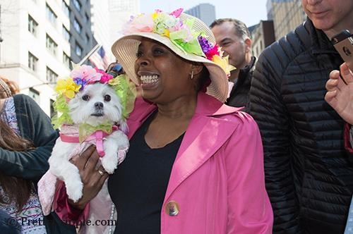 woman with couture dog at the easter hat parade in NYC