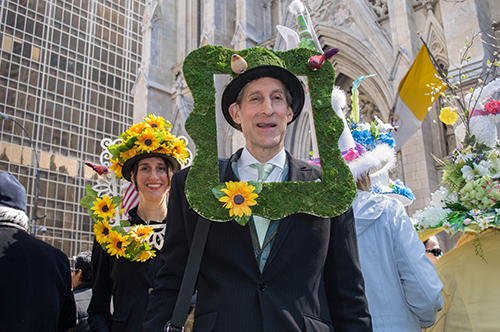 man with grass frame at the easter hat parade nyc