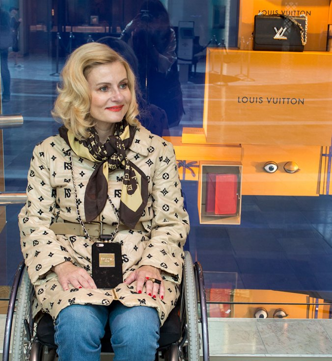 Pretty Cripple in front of Louis Vuitton