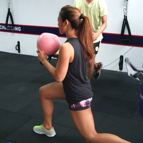 This is me, not used to carrying big kettlebells and holding them this way!